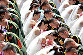 Dongguan. 31st July, 2015. Photo taken on July 31, 2015 shows a group wedding for soldiers in Dongguan City, south China's Guangdong Province. A group wedding was held on Friday for 88 soldiers in Guangdong with the coming of the Army Day and the 88th anniversary of the founding of the Chinese People's Liberation Army, which falls on August 1. © Mao Siqian/Xinhua/Alamy Live News - Stock Image - EYK1TN
