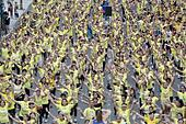 Mandaluyong City, Philippines. 19th July, 2015. People participate in an official attempt to break the Guinness World Record for having the largest Zumba class in Mandaluyong City, the Philippines, July 19, 2015. The Philippines set a new world record for holding the world's biggest Zumba class with a total of 12,975 people taking part in the event. © Rouelle Umali/Xinhua/Alamy Live News - Stock Image - EY0M2E