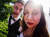"""Kiev, Ukraine. 13th Sep, 2014. People dressed as a zombie parades on a street during a zombie walk -- In Kiev passed the crowd of walking dead. One of the main requirements of the parade was, """"Let's eat brains, but reserve the mud!"""" © Igor Golovnov/Alamy Live News - Stock Image - E7C830"""