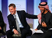 epa04414153 Matt Damon, US actor and Co-founder, Water.org jokes with Mohammad Parham Al Awadhi (R), Co-founder, Peeta Planet during a discussion at the Clinton Global Initiative in New York, USA, 23 September 2014.  EPA/RAY STUBBLEBINE - Stock Image - E7YMDH