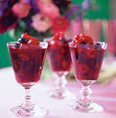 Berry compote in three glasses on table in the open air - Stock Image - B47073