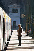 sao bento train station man standing waiting porto portugal - Stock Image - C0TDWD