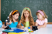 kids group of student girls at school classroom as children teamwork - Stock Image - C5NRJJ