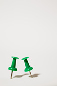 Two green thumbtacks - Stock Image - C1ADGM