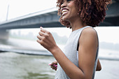 Young woman jogging by bridge, Dusseldorf, Germany - Stock Image - DT6C40