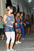 Cuban teenagers, youth, dancing on the street night time. Cienfuegos, Cuba, November 2010 - Stock Image - CWKER4