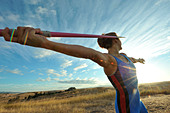 Caucasian athlete aiming javelin - Stock Image - CTGRD8