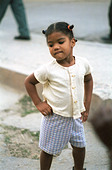 Santiago de Cuba, Cuba, the little girl with the hands in the hips - Stock Image - D15C1Y