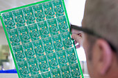Close up of engineer examining printed circuit board in laboratory - Stock Image - CP9GX5