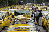 Budapest, Hungary. 16th June, 2015. Taxi drivers take part in a demonstration in central Budapest, Hungary, on June 16, 2015. Hundreds of taxi drivers turned up in their yellow cabs at a demonstration against unregulated car-sharing apps such as Uber, demanding the government to carry out a solution. © Attila Volgyi/Xinhua/Alamy Live News - Stock Image - EW0E4P