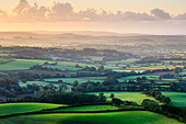 Early morning views across west Dorset from Pilson Pen hill fort which is the highest point in Dorset. - Stock Image - DGKKRW