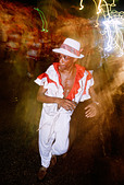 Havana Cuba Cuban man dancing in the street during the annual summer carnival celebrations - Stock Image - A1JWM5