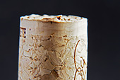 technical cork with disks at the end and glued agglomerate cork in the middle - Stock Image - BEAW6F