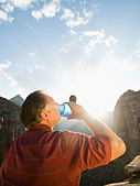 A man drinking water at Red Rock - Stock Image - BD59PC