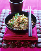 Fried rice with minced chicken and coriander leaves - Stock Image - BJP1HC