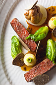 Danish Beef with Celery, Small Cabbages, Sweetbreads and Black Truffles prepared by Kristian Meller and Rune Jochumsenat, Chefs - Stock Image - BWRMBK