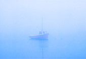 Lone boat on misty still water, Osterville, Cape Cod, MA - Stock Image - CTYF7F