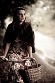 Girl with a bicycle in a vintage 1940 style - Stock Image - BPBW70
