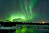 Northern Lights, also known as Aurora Borealis at moonset near Inari. Lapland, Finland. - Stock Image - C5YF56