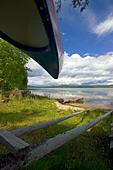 Canoe on Beach of Lake Flaten near Torsby in Varmland County Sweden - Stock Image - AGR9B4