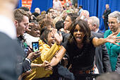 First lady Michelle Obama greets guests during a campaign event for Illinois Governor Pat Quinn at the University of Illinois - Stock Image - E8GGH5