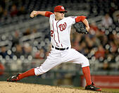 Washington, DC, USA. 25th Sep, 2014.  Washington Nationals relief pitcher Drew Storen (22) works against the New York Mets in the ninth inning of the second game of a doubleheader at Nationals Park in Washington. The Nationals beat the Mets, 3-0. © ZUMA Press, Inc./Alamy Live News - Stock Image - E7XPAH