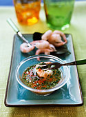 Shrimps with chili herb sauce - Stock Image - BJJTF6