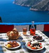 Greek food and wine at a taverna in Kambi, Zakynthos (Zante), Ionian Islands, Greece - Stock Image - BPF4RW