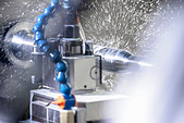 Water spraying on machinery in factory - Stock Image - D5576J