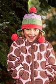 Portrait of girl (4-5) with mouth open, wearing hat with earflaps - Stock Image - E8PBJ5