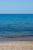 Blue sea and small pebbled beach. Cyprus - Stock Image - E46DB6