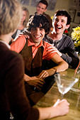 Young friends hanging out and at bar together - Stock Image - B720F1