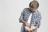 Man reading book - Stock Image - CXWR55
