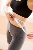 girl female measure waist tape sports diet trim - Stock Image - B2FJD5