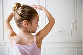 Young girl performing a ballet move - Stock Image - B07WHJ