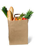 a brown paper shopping bag with vegetables and bread - Stock Image - A9JGC3