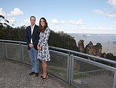 epa04169729 Britain's Prince William, left, and his wife, Kate, Duchess of Cambridge, pose in front of the Three Sisters rock formation in the Blue Mountains during a tour of Echo Point in Katoomba, , April 17, 2014. The royal couple, along with Prince George, are on the 10-day official visit  EPA/Rick Rycroft POOL - Stock Image - DYJR2P