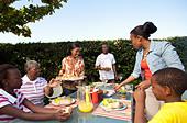 Family having lunch outside, Johannesburg, South Africa - Stock Image - C2YKBN