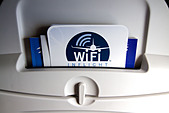 Inflight WiFi advertised on the back of airplane seat. WiFi the next generation of inflight entertainment. - Stock Image - DDJ61G