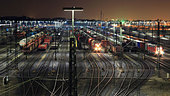 Train yard lit up at night - Stock Image - CFABHT