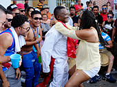 MIAMI - MARCH 9, 2014: People dancing in the streets during the 37th Calle Ocho festival, an annual event that takes place over Eight Street in Little Havana featuring plenty of music, food, and  it is the biggest party in town that celebrates hispanic heritage. - Stock Image - DX344D