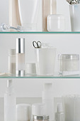 Medicine cabinet full of skincare products - Stock Image - C819R6