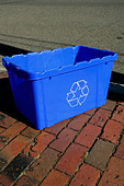 Urban Scene of a Blue Recycling Bin on a Brick Sidewalk Copy Space - Stock Image - B4BDFC