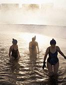 Three mature women standing in the sea - Stock Image - B019B0