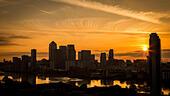 London, UK. 25th June, 2015. Sunrise over Canary Wharf Business Park Buildings © Guy Corbishley/Alamy Live News - Stock Image - EWEXK3