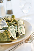 Paper currency on dinner plate, studio shot - Stock Image - CR0PB9