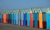 Brighton has rows of colourful beachhuts on the seafront. The doors are painted bright colours. - Stock Image - C92HP6