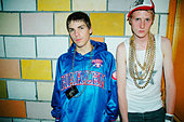 2 young guys, wearing gold chains and baseball caps at a Nu Rave club night in Antwerp. Belgium, 2006 - Stock Image - BFP6DW