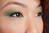 Cropped image of Asian woman looking away - Stock Image - CWDEMK