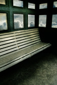 Photo of an empty bench at the seaside - Stock Image - ACFWXA